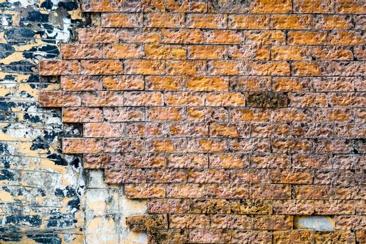 orange brick wall is crack and break and corroded by rainwater
