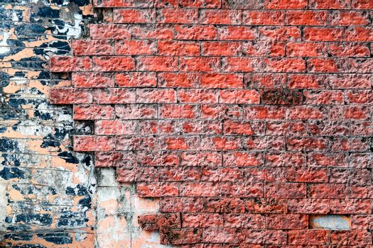 red brick wall is crack and break and corroded by rainwater