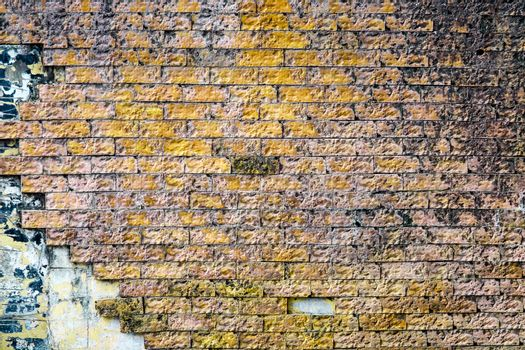 yellow brick wall is crack and break and corroded by rainwater