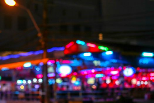 blur colorful of nightlight at night market in pattaya city