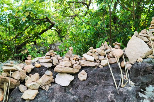 rock is arranged as a pagoda for worship of lord buddha