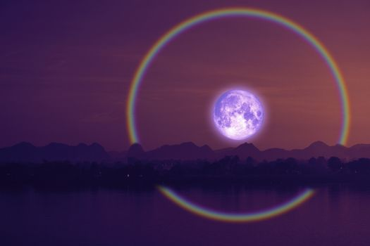 Full hay moon halo back silhouette mountain and river