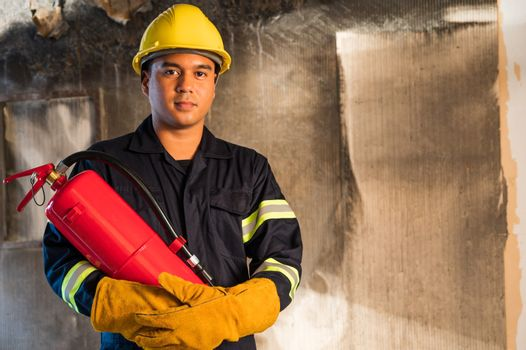 Young asian Fireman,Firefighters use fire  extinguishing that ar