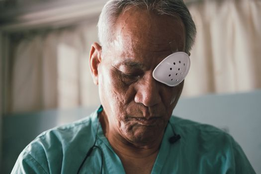 patient covering eye with protective shield after eyes cataract