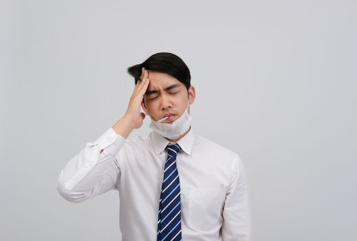 businessman man with thermometer feeling sick, headache from flu covid 19 virus bacteria infection pollution