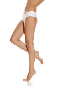 pretty feminine legs and white panties