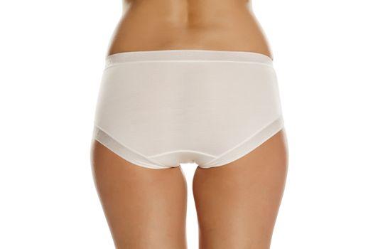 pretty feminine buttocks and white panties