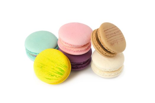 sweet delicacy macaroons variety closeup. Macaroons on white bac