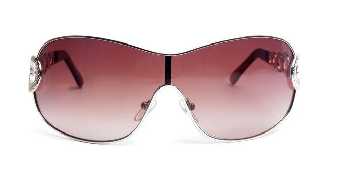 elegant female sunglasses on white