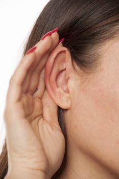 hand behind ear,
