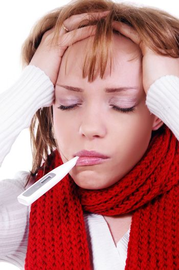sick woman with warm clothes and thermometer