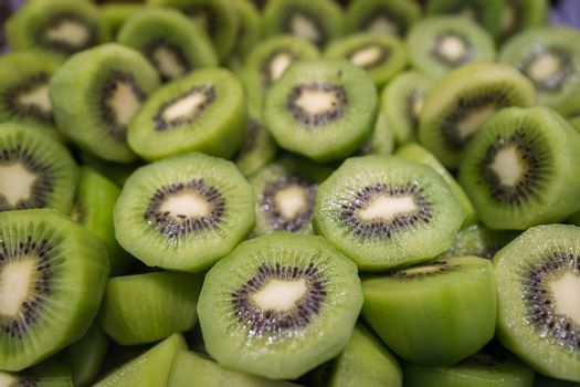 Pile of freshly cut delicious juicy kiwis for sale on market in China