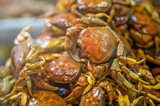 A selective focus shot of crispy delicious cooked small crabs served together in a plate