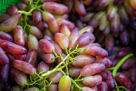 Pile of fresh and delicious red grapes for sale on market in China