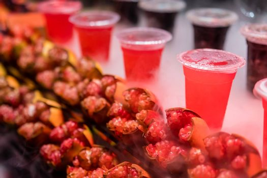 Chilled freshly squeezed pomegranate juice in a transparent plastic cup for sale on a stall in Muslim Quarter in Xian town, Shaanxi Province, central China