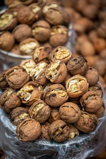 Bunch of fresh walnuts in a bowl for sale on a street market in China