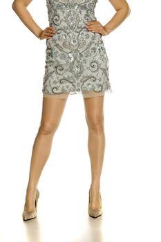 Pretty female legs with short dress