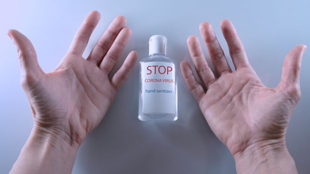 Using a bottle of hand sanitizer against Corona virus.