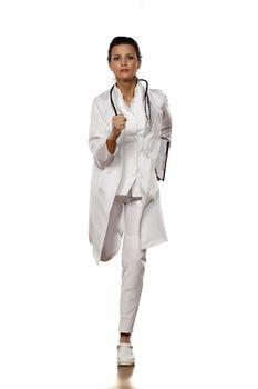 woman doctor in uniform running