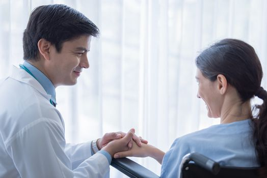 A doctor take care of sick patient woman at the hospital or medical clinic.