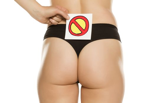 Female bottom with forbidden sign drawn on paper