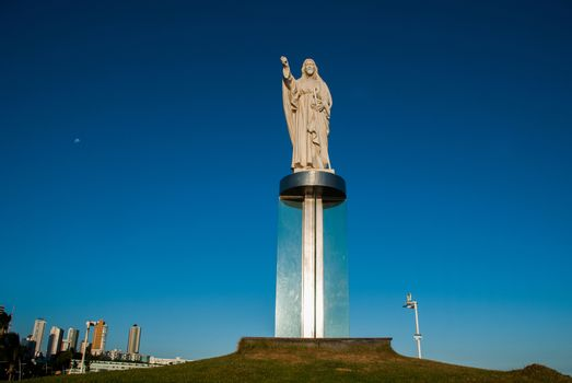 SALVADOR, BAHIA, BRAZIL: Jesus Christ monument in the city of Salvador on the background of blue sky