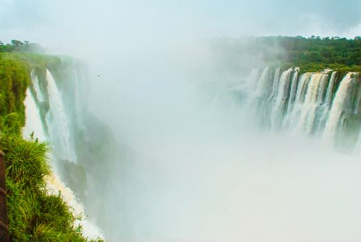 Iguazu Falls on the border of Argentina and Brazil, view of Devil's Throat waterfall, the largest in the Iguazu cascades system. UNESCO World Heritage site.
