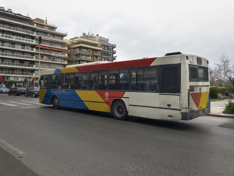 No crowd at a Thessaloniki Urban Transport Organization bus, stopped with alarm lights on the road.