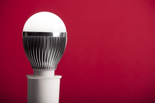 LED bulb in holder on red