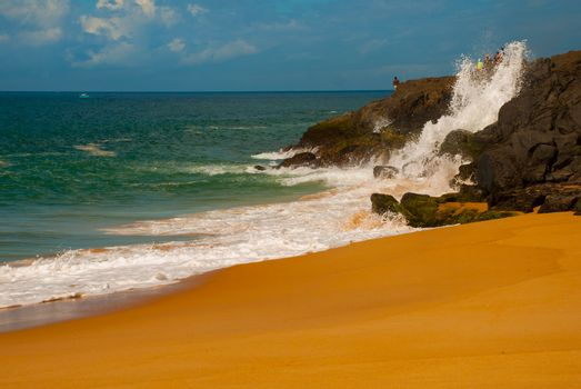 SALVADOR, BAHIA, BRAZIL: Brazilian beach with yellow sand and blue sea in Sunny weather. Sao Salvador da Bahia de Todos os Santos. South America.