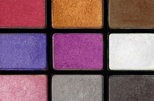 closeup of colorful cosmetics eyeshadows