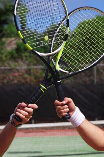two tennis players with rackets