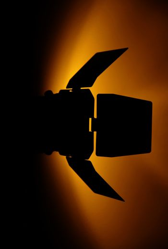 studio flash silhoutte with orange light on wall