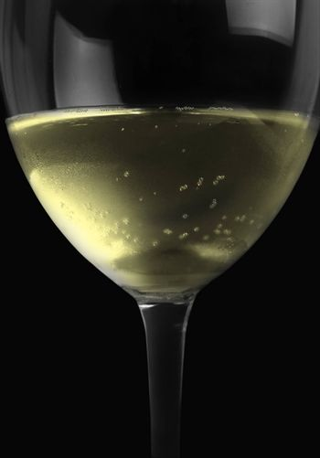 white wine drink in the glass on black