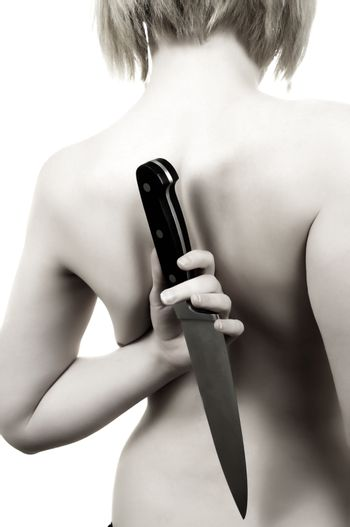 bare woman back with knife.toned picture