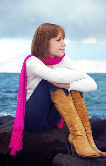 girl looking at sea. evening time