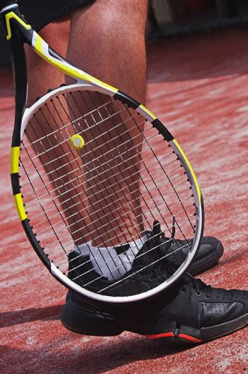 tennis player legs with racket