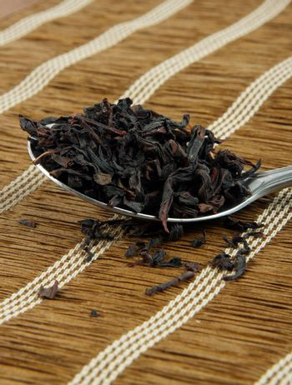 tea leaves on spoon closeup.shallow DOF