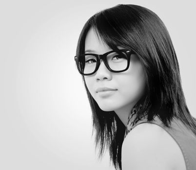 beautiful asian girl with eyeglasses.toned picture