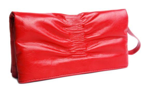 red female handbag over white