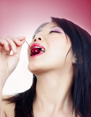 portrait of beautiful fashion asian woman with cherry