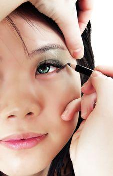 asian girl applying make up