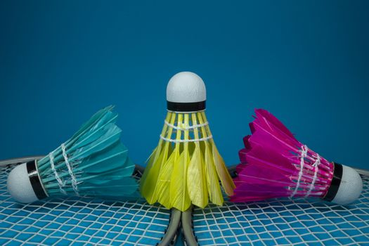 Feathered shuttlecocks and badminton rackets