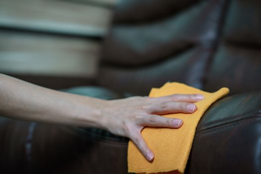 Women Hand cleaning sofa disinfectant  for corona virus or Covid-19 protection.