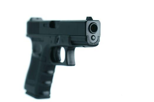 Pistol isolated on white background.