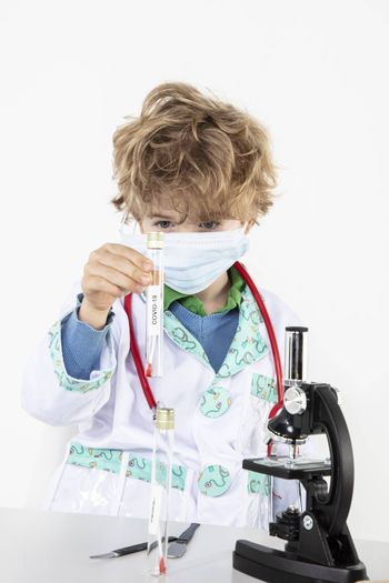 young doctor works in his laboratory, does tests on COVID-19