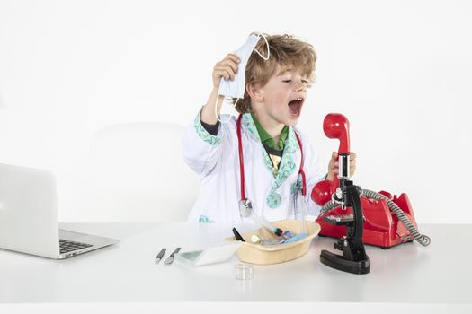 young doctor screams into headphones during a telephone conversation