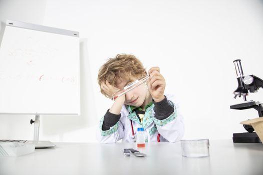 depressed doctor looking at swab sample, coronavirus tests