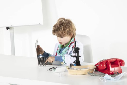 young doctor works on the computer in his office