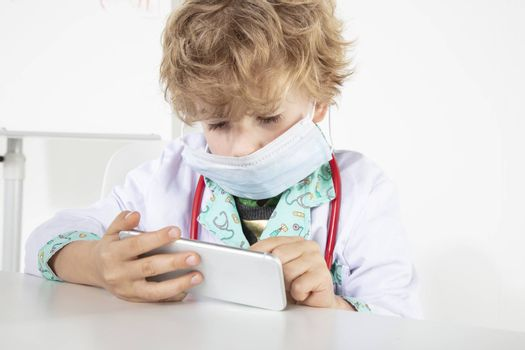 young doctor uses the phone, sitting in his office